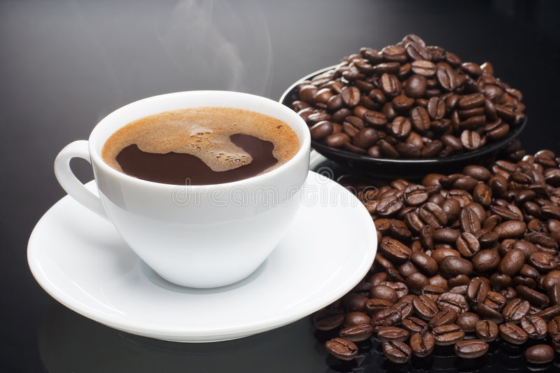 Hot coffee with beans royalty free stock images