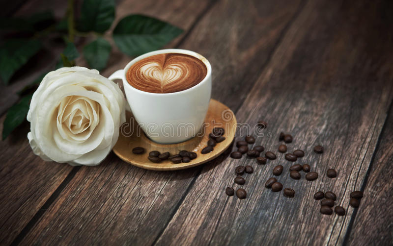 Hot Coffee And Beautiful White Rose Stock Image