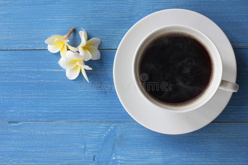 Hot coffee on a blue wooden floor. stock photos