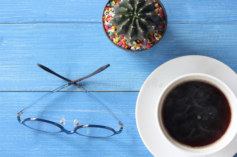 Hot coffee on a blue wooden floor. royalty free stock photos