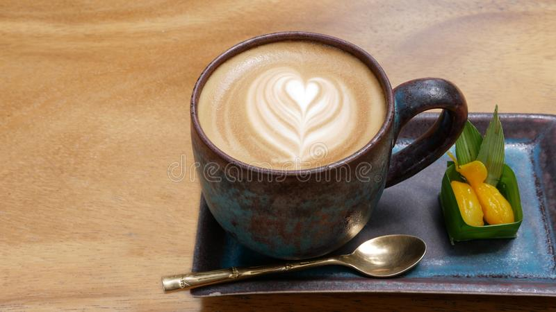 Hot coffee cappuccino latte art with thai style dessert top view royalty free stock photo