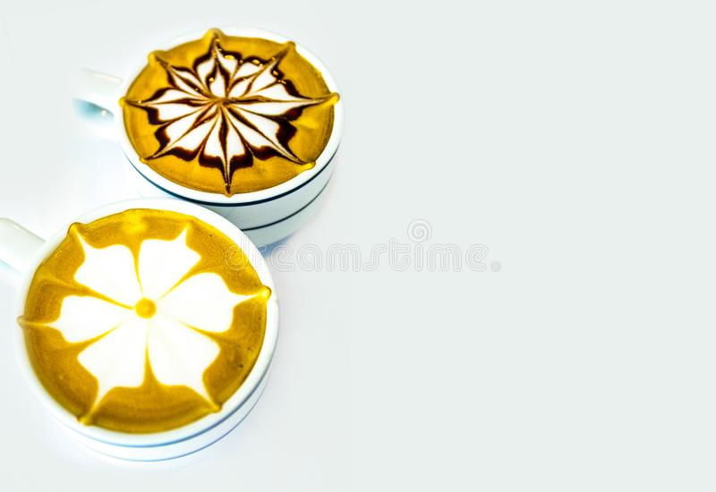 Hot coffee cappuccino latte art on white background stock photography