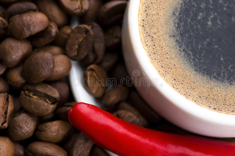Hot coffee with chili royalty free stock photography