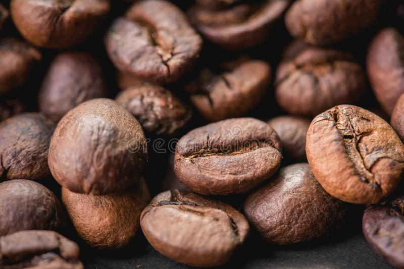 Coffee incup and coffee beans are the background. royalty free stock images