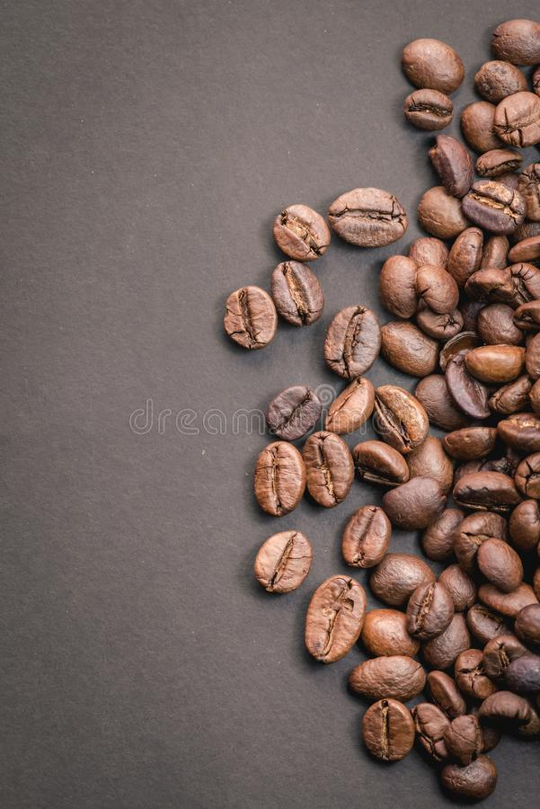 Coffee incup and coffee beans are the background. royalty free stock photo