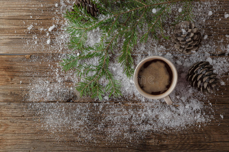 Hot Coffee cup on a frosty winter day window background /Christmas holidays background/ Winter cozy background stock photo