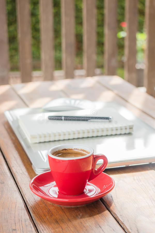 Hot coffee cup on wooden work station. Stock photo stock photos