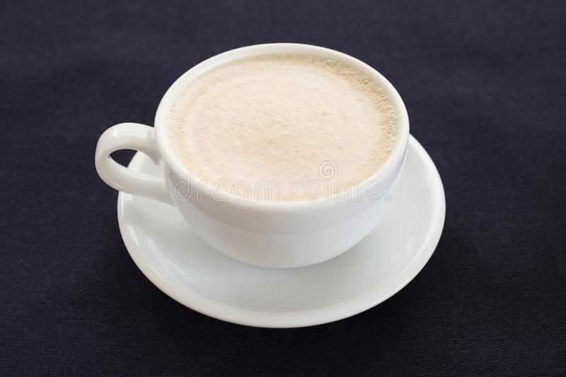 Hot coffee foamed  on table. Hot coffee foamed  isolated on table royalty free stock image