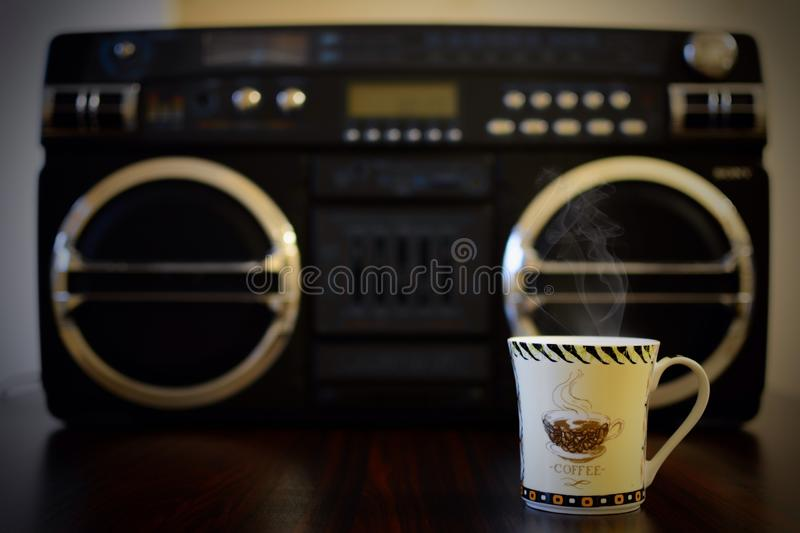 Hot coffee and music player. Coffee cup & music stock images