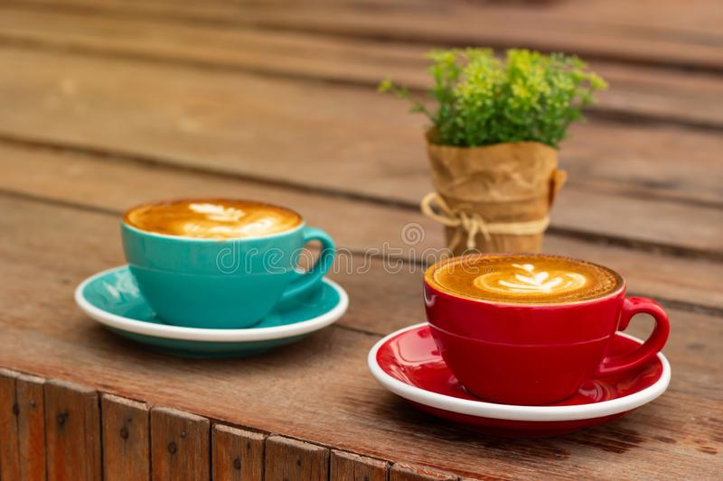 Hot coffee with latte art. Favorite caffeine beverage. Refreshment drink in morning royalty free stock photography