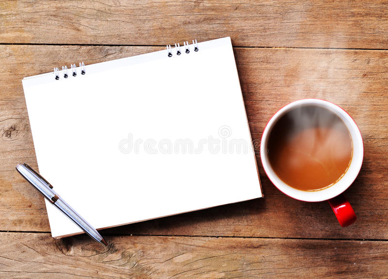 Hot coffee for morning. Hot coffee with note on wood background for morning royalty free stock photos