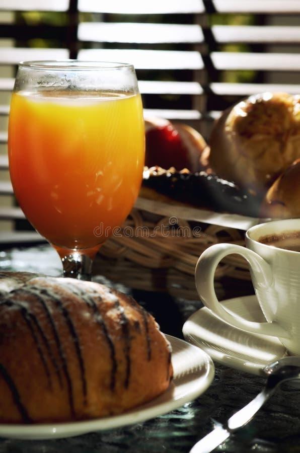 Hot coffee and orange juice stock photos
