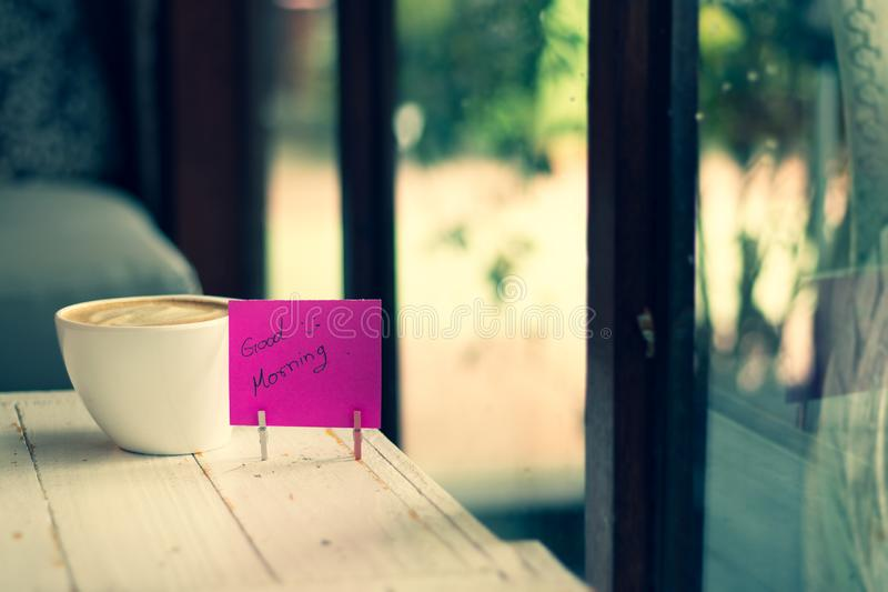 Coffee and paper note with good morning. Hot coffee and paper note with good morning stock photography