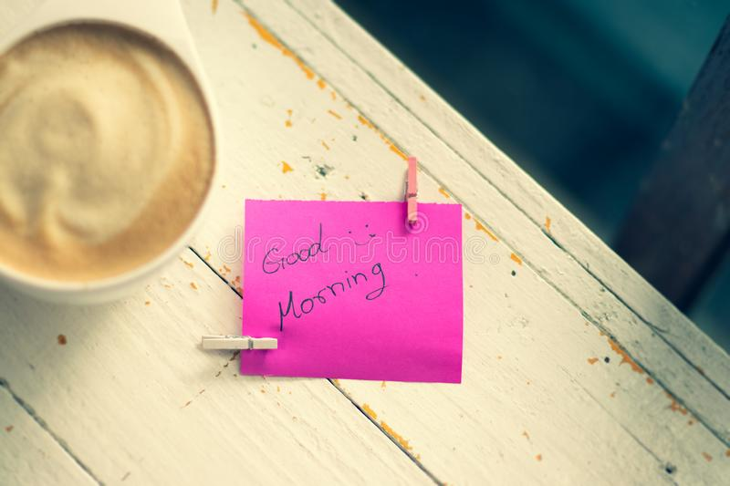 Hot coffee and paper note with good morning. Paper note pink color stock image