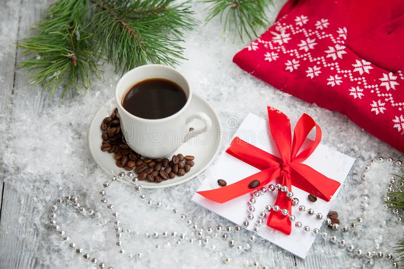 Hot coffee, red warm pullover and letter from Santa Claus on a snowy background. stock photos