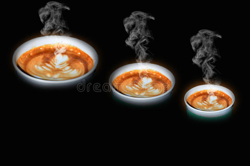 Hot coffee takeaway cups in three size. On brown background royalty free stock photography