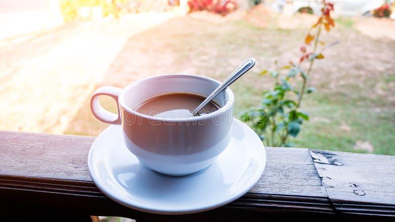 Hot coffee in white ceramic cup. Closeup hot coffee in white ceramic cup royalty free stock images