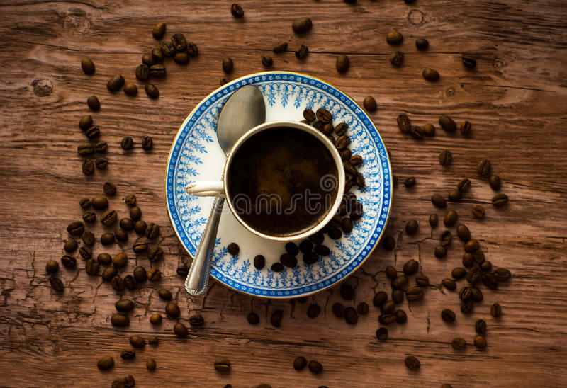 Hot coffee. On a wooden table royalty free stock photos