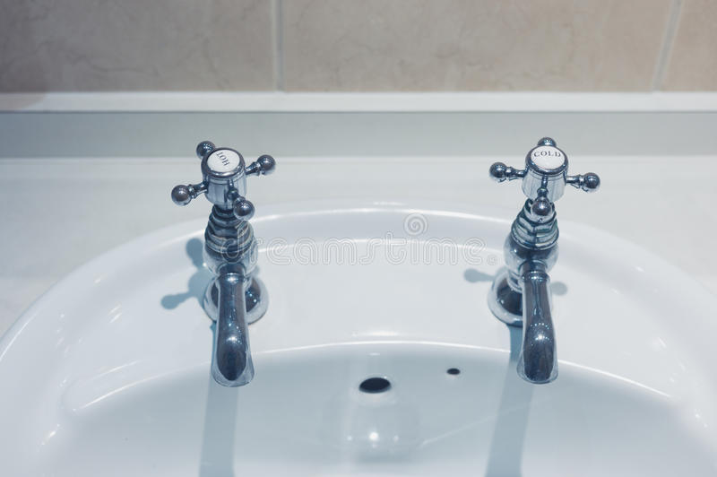 Hot And Cold Taps In Bathroom Stock Image - Image of bathroom ...