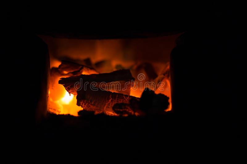 Hot combustion with ash in the fireplace. Abstract royalty free stock image