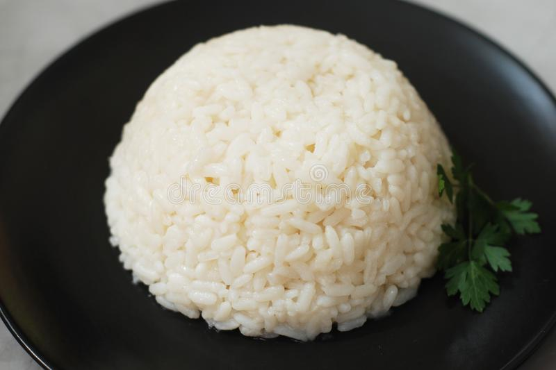 Hot Cooked Boiled White Ricen Black Background, Isolated. stock photos