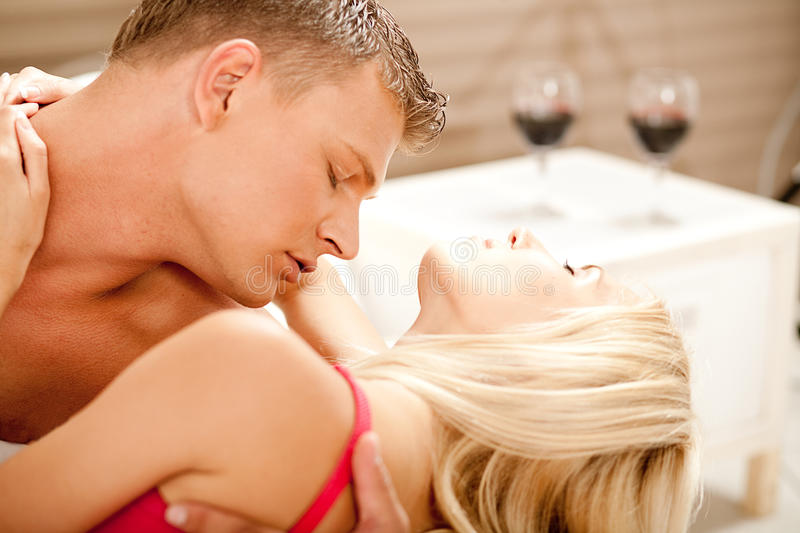 Hot couple embracing and making love stock photos