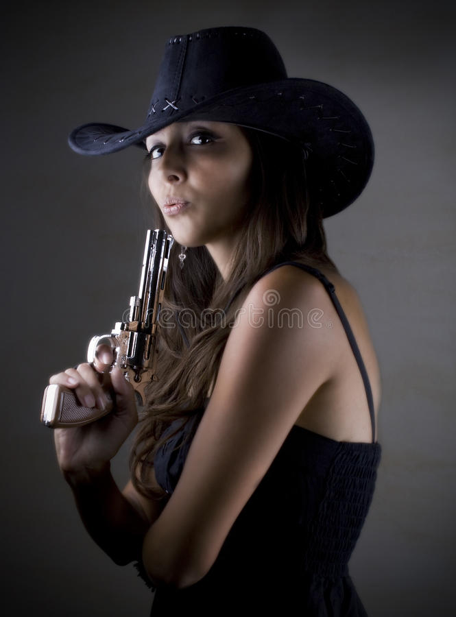 Hot cowgirl with gun stock image