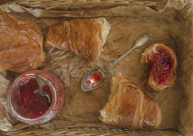 Hot croissants and strawberries marmalade stock photos