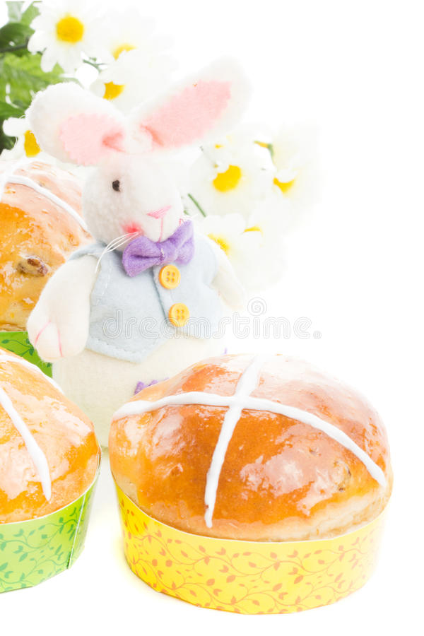 Hot cross buns with easter bunny. Easter hot cross buns with a fun rabbit and camomile isolated on white stock images