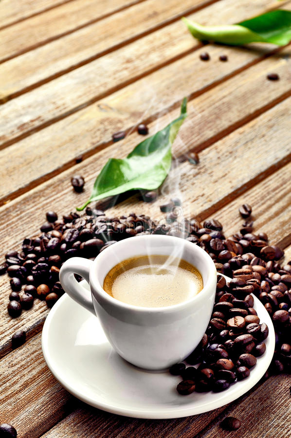 Hot Cup of coffee. A hot cup of coffee with coffee-beans stock images