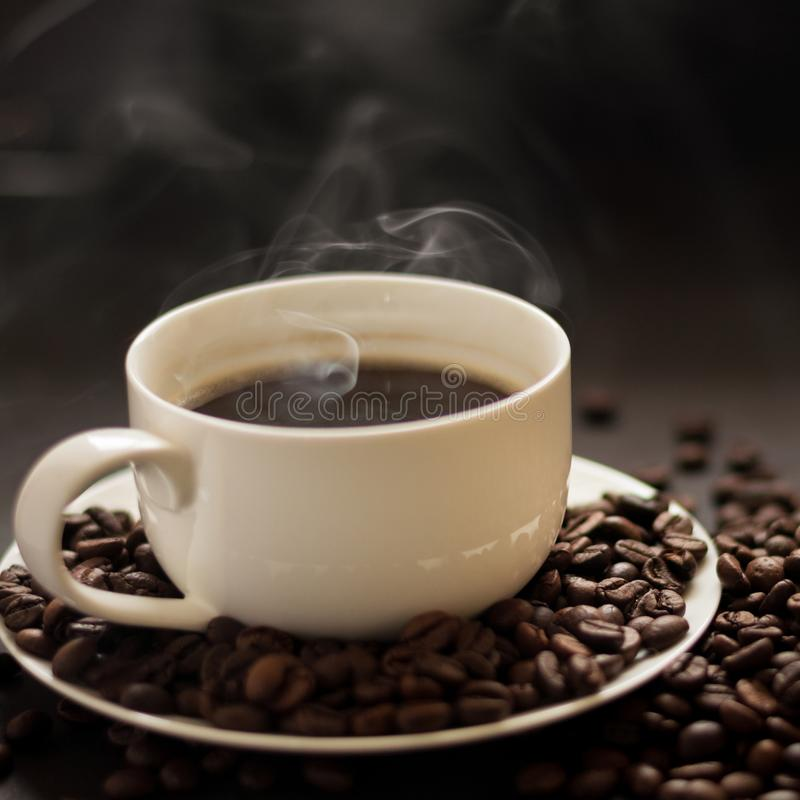 Hot cup of coffee with smoke royalty free stock images