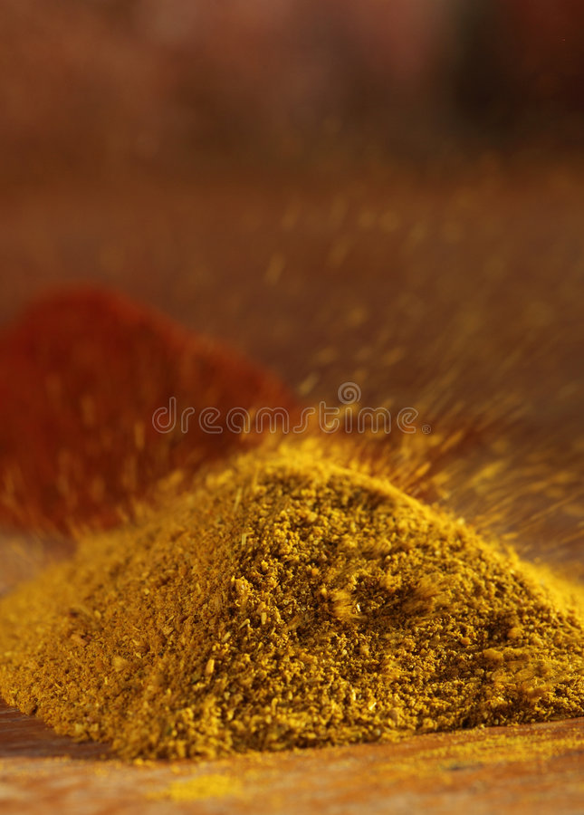 Download Hot Curry Powder In A Pile Flying Away Stock Photo - Image of color, close: 9315316