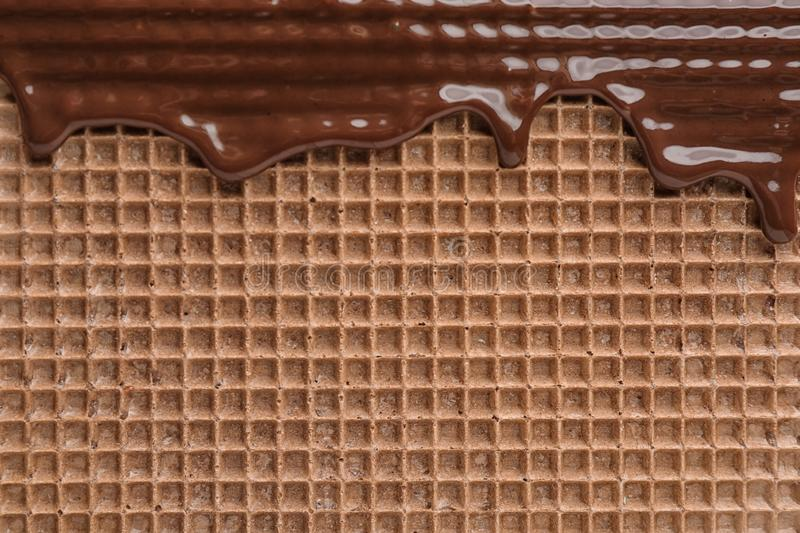 Hot dark chocolate on wafer, closeup. Crispy food stock images