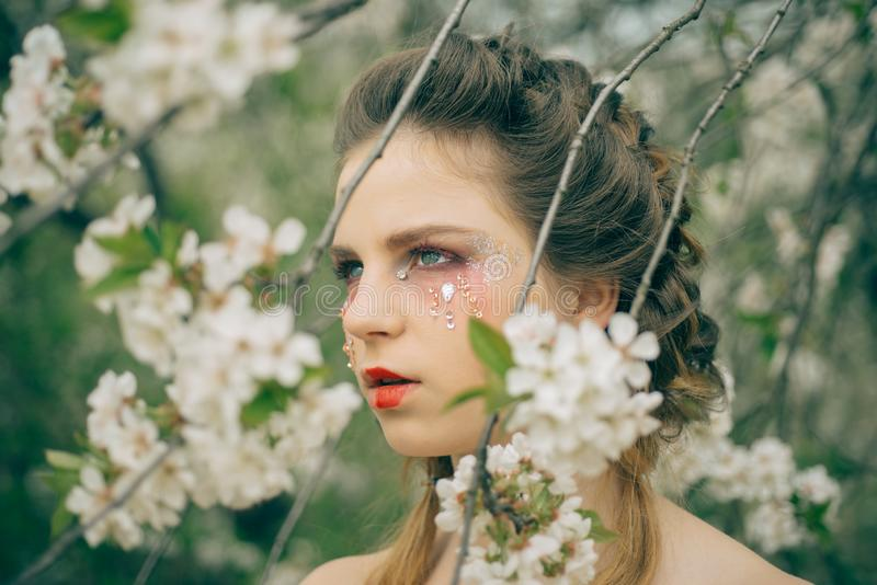 Hot day. Summer girl at blooming tree. face and skincare. womens health. allergy to flowers. Natural beauty and spa royalty free stock photography