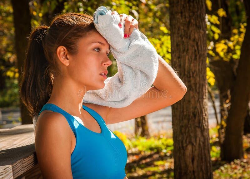 Girl Runner resting stock photo