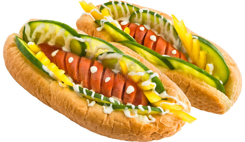 Hot dog. Two hot dog with pepper and cucumbers decorated with mayonnaise isolated on a white background stock image