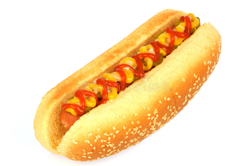 Hot dog. Against white background with onions, pickles,ketchup and mustard on top royalty free stock images