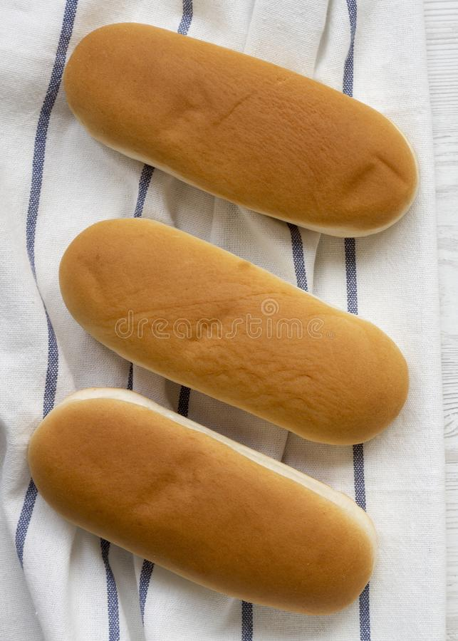 Hot dog buns on cloth, top view. Flat lay, from above, overhead. Closeup.  royalty free stock photos