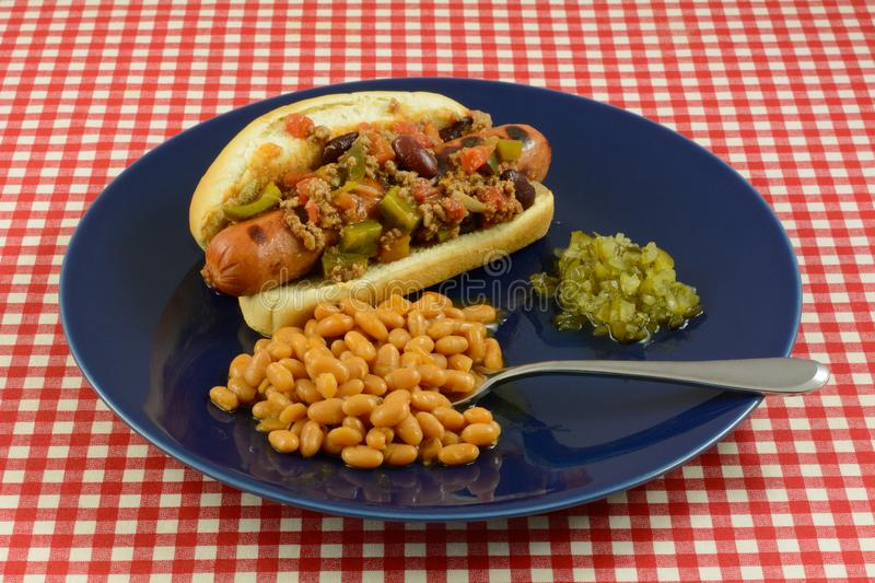 Hot Dog with chili baked beans and sweet relish royalty free stock images