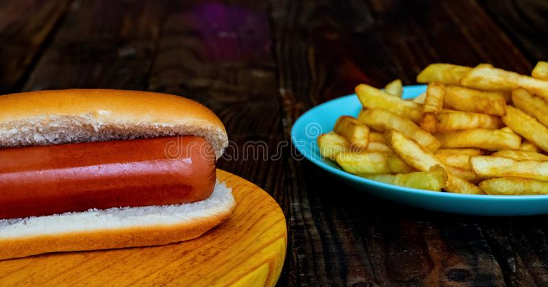 Hot dog on the grill royalty free stock photo