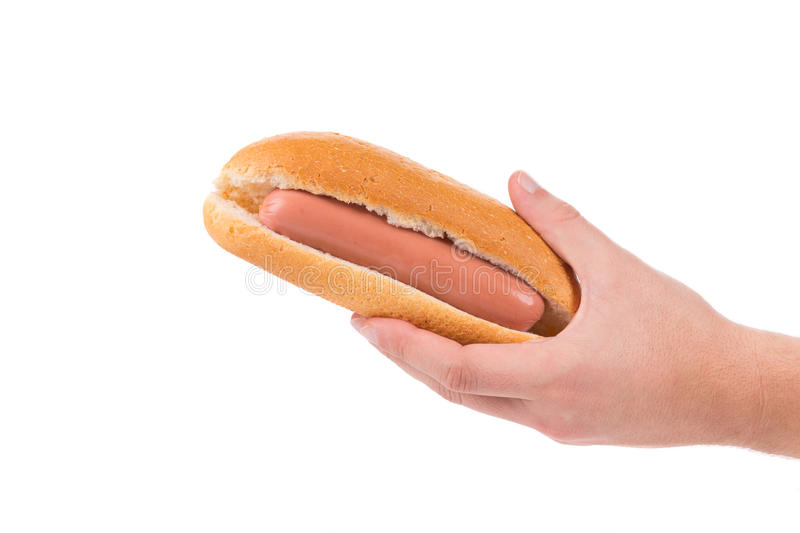 Hot dog cru de prise de main photo stock