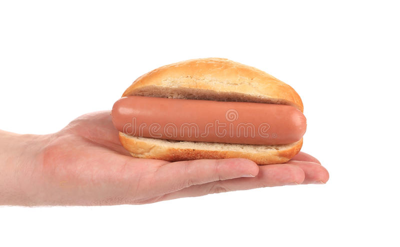 Hot dog de prise de main. photographie stock