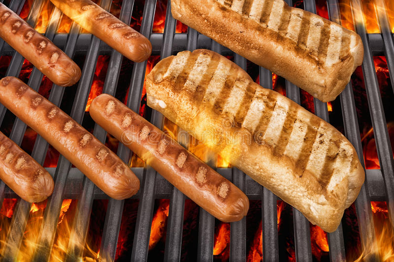 Hot dog on grill royalty free stock photo
