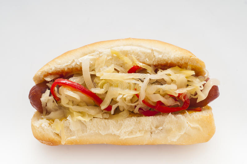 Hot Dog. Grilled Hot Dog with sauerkraut and hot red peppers royalty free stock images