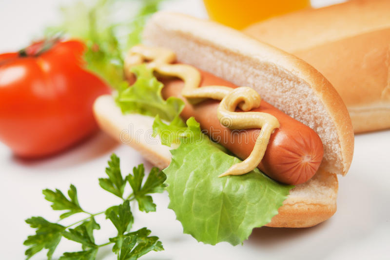 Hot dog with mustard stock photos