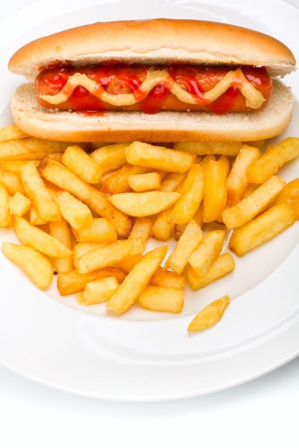 Hot dog with mustard, ketchup and fries stock photos