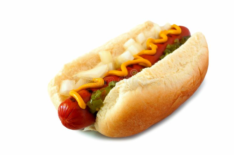 Hot dog with mustard, onions and relish isolated on white. Hot dog with mustard, onions and relish, side view isolated on a white background royalty free stock photos