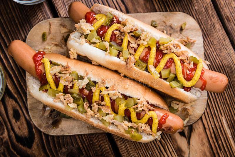 Hot Dog with onions, cucumbers and sauces royalty free stock photo