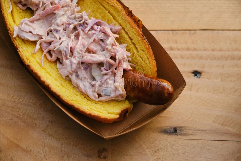 Hot dog sandwich with coleslaw salad, delicious street food royalty free stock images