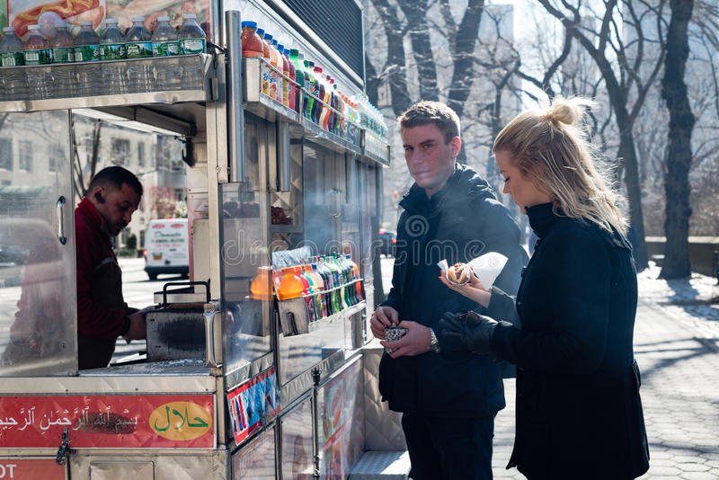 Hot Dog Stand and Young Couple in Central Park - New York City stock images